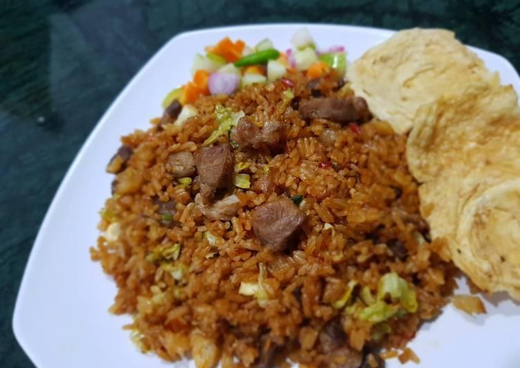 Resep: Nasi goreng kambing dengan sayur kol yang bikin ketagihan