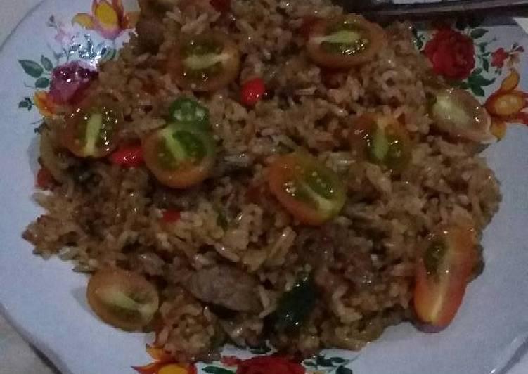 Cara mengolah Nasi goreng kambing ala resto
